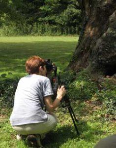 Jan Dodgins shooting photos at Arts Gathering at Mill Meadow