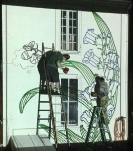 John D'Amico painting projected outlines for B-Belle's mural in Romney, WV