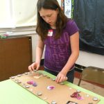 placing items just right for mixed-media art